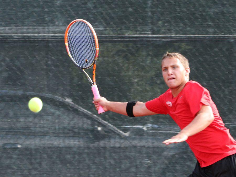 Senior Logan Mayer chases down a shot at #2 singles during a match earlier this season. The tennis team earned its first trip to the state finals by beating Terre Haute South in the semi-state this weekend.