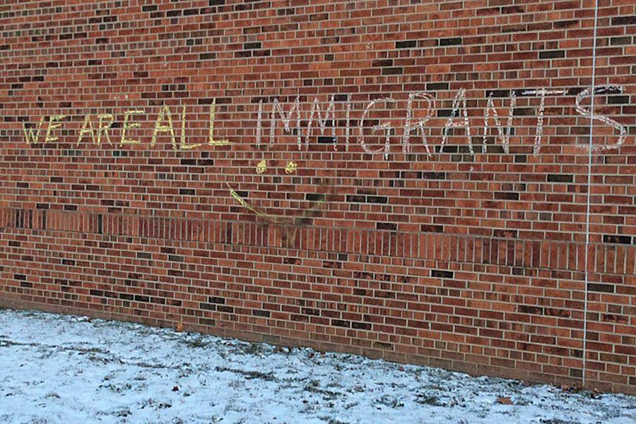 Chalk sends a message of displeasure on Monday morning, January 30 on the wall outside of the Career Center. Students were reacting to the executive orders signed by President Trump concerning immigration into the United States.