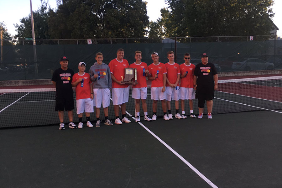The varsity squad and coaches Randy Hollingsworth and Cindy McKibbin holding their new sectional trophy.