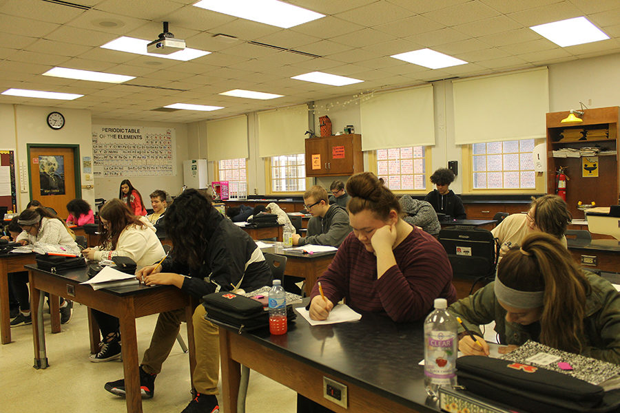 Sitting in Mrs. Hawley's second period Intro to Chemistry Physics class are many frehsmen students.