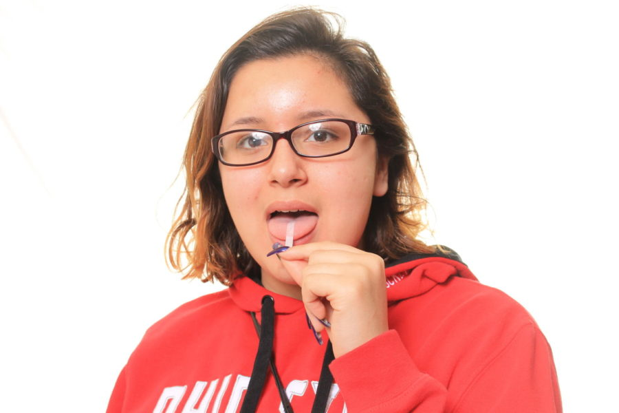 Testing strip in her mouth, senior Mallory Williams finds out she is a Supertaster