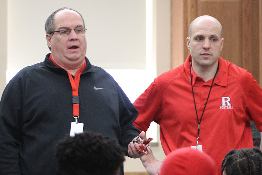 Standing next to the athletic director Larry Cochran, RHS health and physical education teacher Tony Sonsini is announced as the new football head coach.
