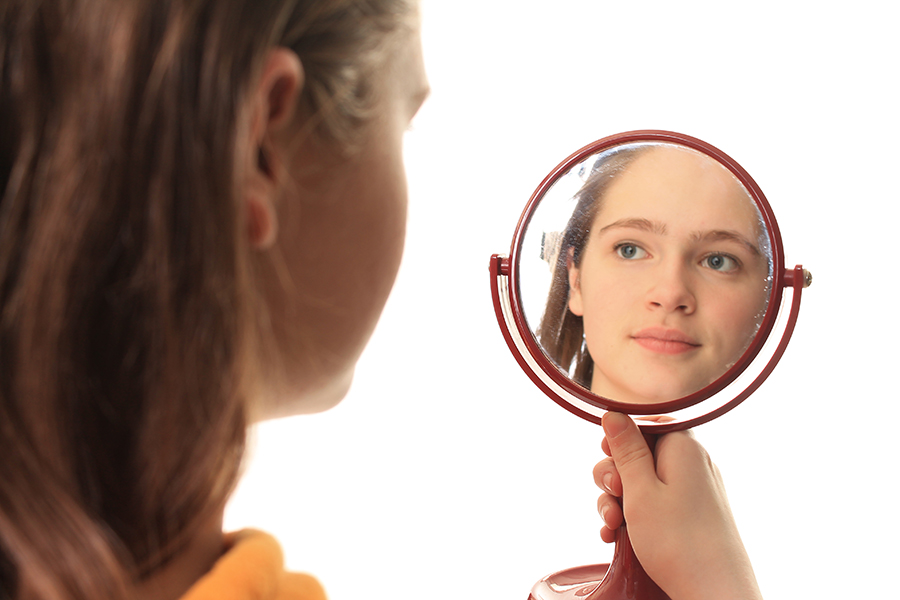 She's glancing miserably into the mirror thinking horrible things about herself. Model: Mallory Bolser
