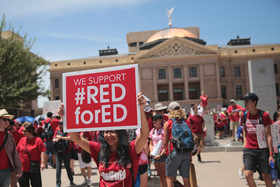 Supporters+of+%22Red+for+Ed%22+at+a+protest+hosted+by+the+Arizona+Education+Association+at+the+Arizona+State+Capitol+complex+in+Phoenix%2C+Arizona.