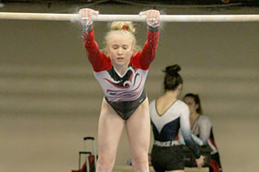 Freshman Lizzy Ruger leads gymnasts to State for the first time in 39 years.