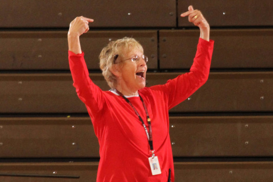 Cheering on students during the Pep rally, principal Woolpy excites everyone in the audience. Woolpy had been an assistant principal, before taking on the prominent job as principal.