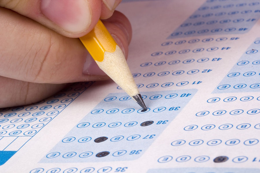 A student filling out answers to a test.
