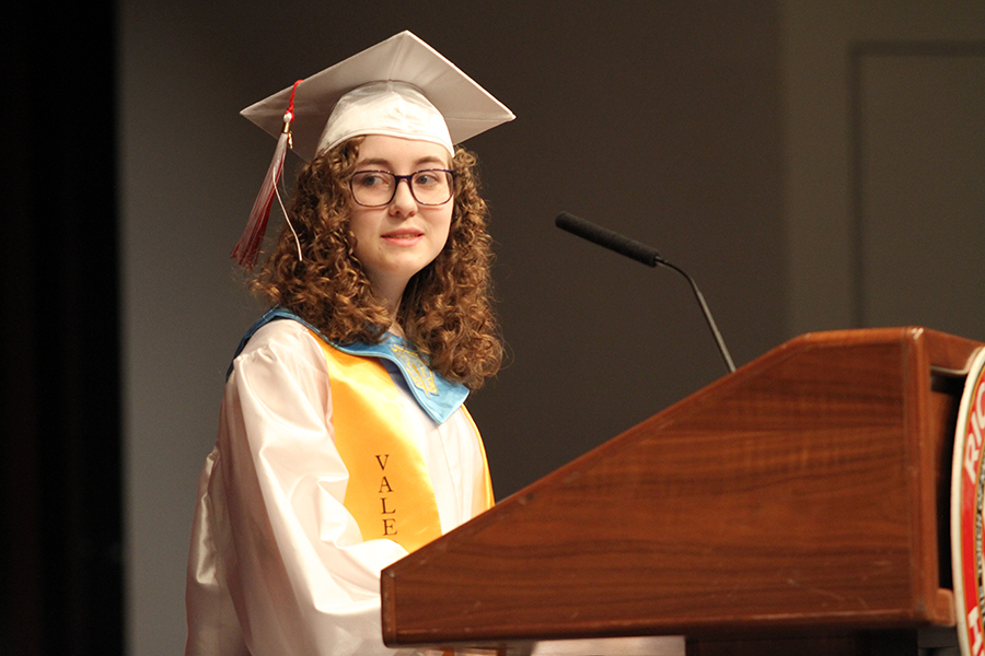 A 2018 valedictorian, Hannah Stiffler, speaks at the Honors and Awards ceremony.