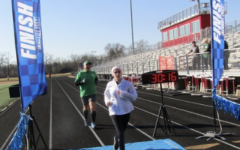 Crossing the finish line, sophomore Lydia Casiano competes in the Shamrock Run.